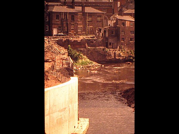Old mill buildings alongside probably the River Mersey near the modern day A560 Knightsbridge.